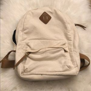Cream white backpack with brown accents